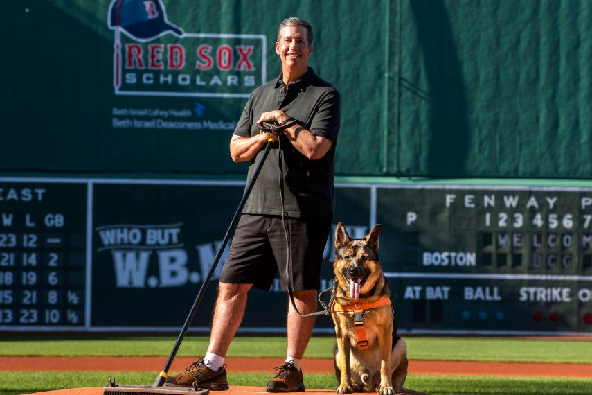 Fenway Park head groundskeeper David Mellor and his service dog Drago. (Stan Grossfeld/Boston Globe via Getty)