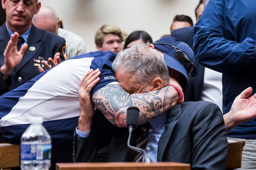 FealGood Foundation co-founder John Feal hugs Jon Stewart. (Zach Gibson/Getty)