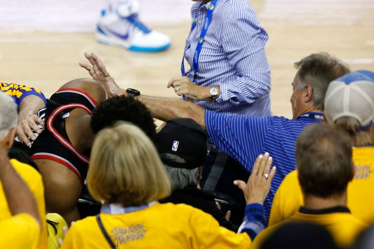 5a0988e0f75 Kyle Lowry #7 of the Toronto Raptors is pushed by Warriors minority  investor Mark Stevens