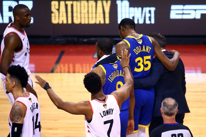 Kevin Durant #35 of the Golden State Warriors is assisted off the court. (Vaughn Ridley/Getty)
