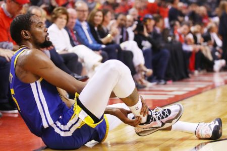 Kevin Durant reacts after sustaining an injury in the NBA Finals. (Gregory Shamus/Getty)