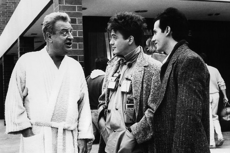 "Rodney Dangerfield talks to Robert Downey Jr in ""Back To School."" (Orion Pictures/Getty)"
