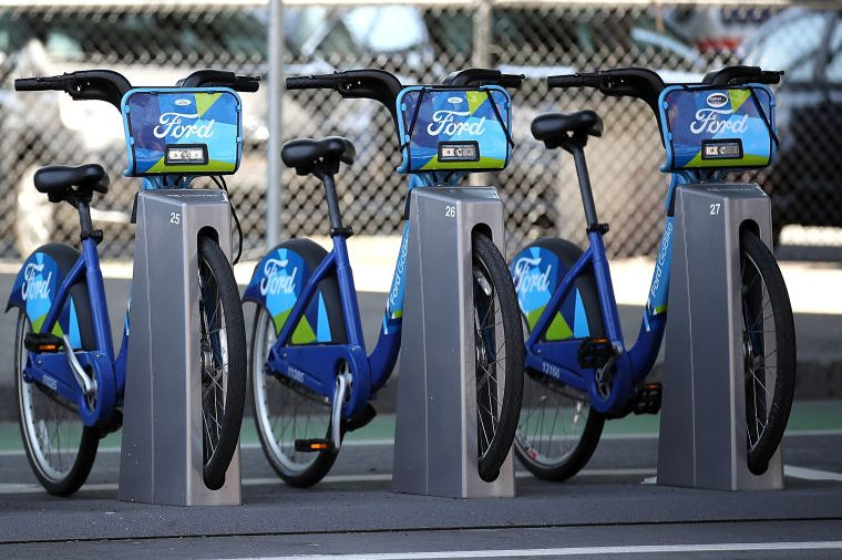 Ford GoBikes sit in a dock in San Francisco. (Justin Sullivan/Getty)