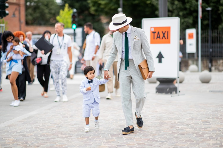 That kid is already an icon thanks to his dad. (Photo by Christian Vierig/Getty Images)