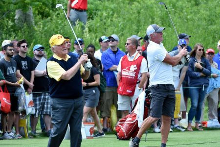 Jack Nicklaus warms up with Brett Favre at the American Family Insurance Championship. (Steve Dykes/Getty Images)