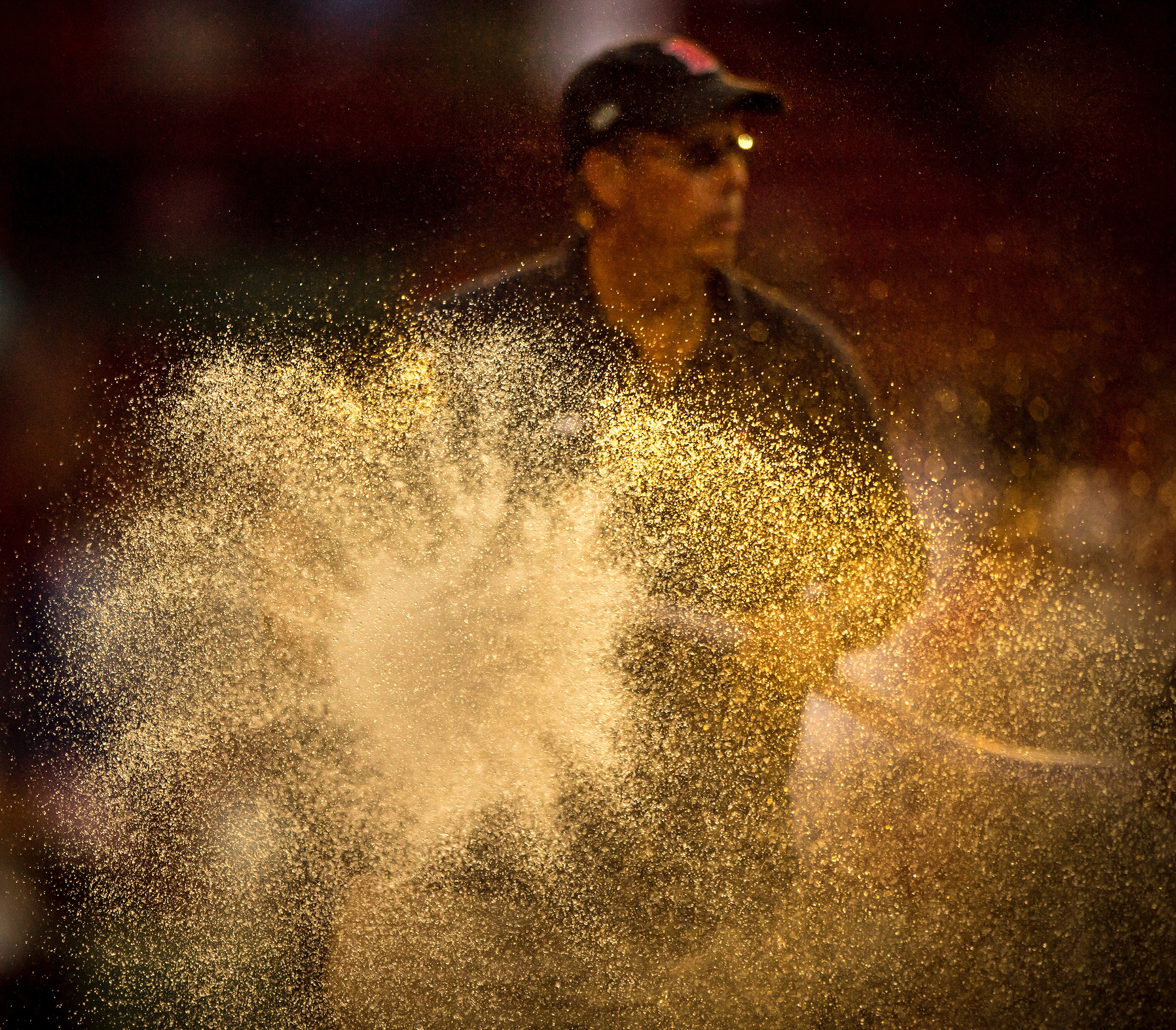 Dave Mellor sprays the hose at Fenway Park.  (Billie Weiss/Boston Red Sox/Getty)