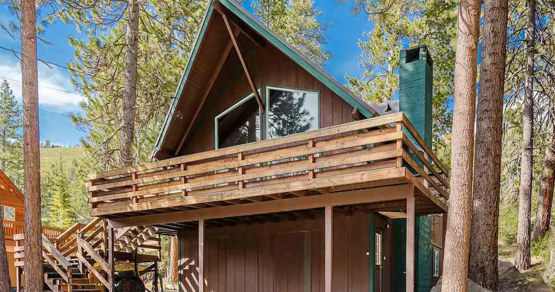 Spend your summer lakeside with three bedrooms and a giant deck
