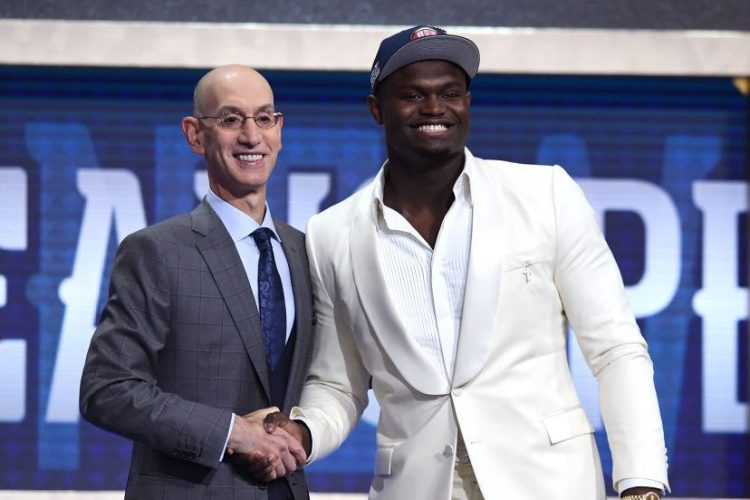 Zion Williamson poses with NBA Commissioner Adam Silver. (Sarah Stier/Getty)
