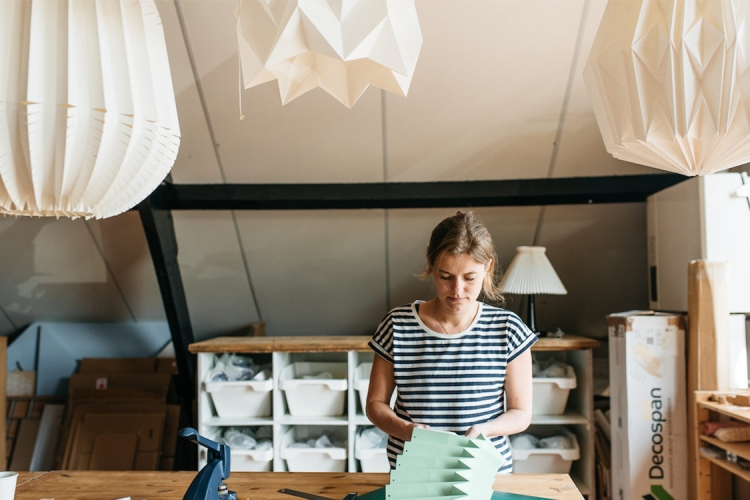 Nellianna van den Baard working on a lampshade (Credit: Etsy).
