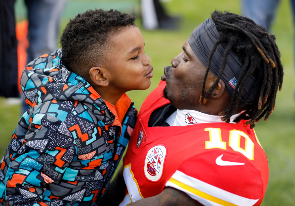 Tyreek Hill teases his son Zev during pregame warmups at Arrowhead Stadium. (David Eulitt/Getty)