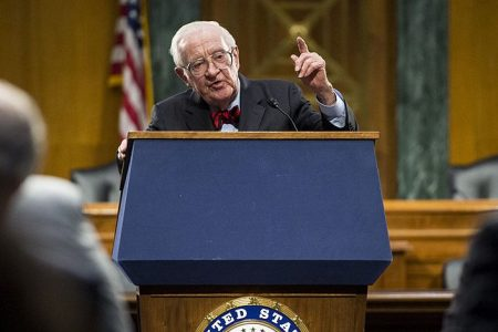 Retired Supreme Court Justice John Paul Stevens points as he recounts his story of witnessing Babe Ruth call his home run. (Bill Clark/CQ Roll Call)