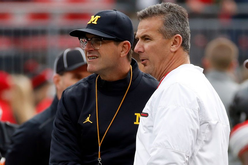 Ex-OSU head coach Urban Meyer and Jim Harbaugh of the Michigan Wolverines. (Gregory Shamus/Getty)