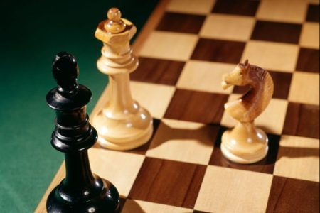 Three pieces on a chessboard. (H. Armstrong Roberts/ClassicStock/Getty)