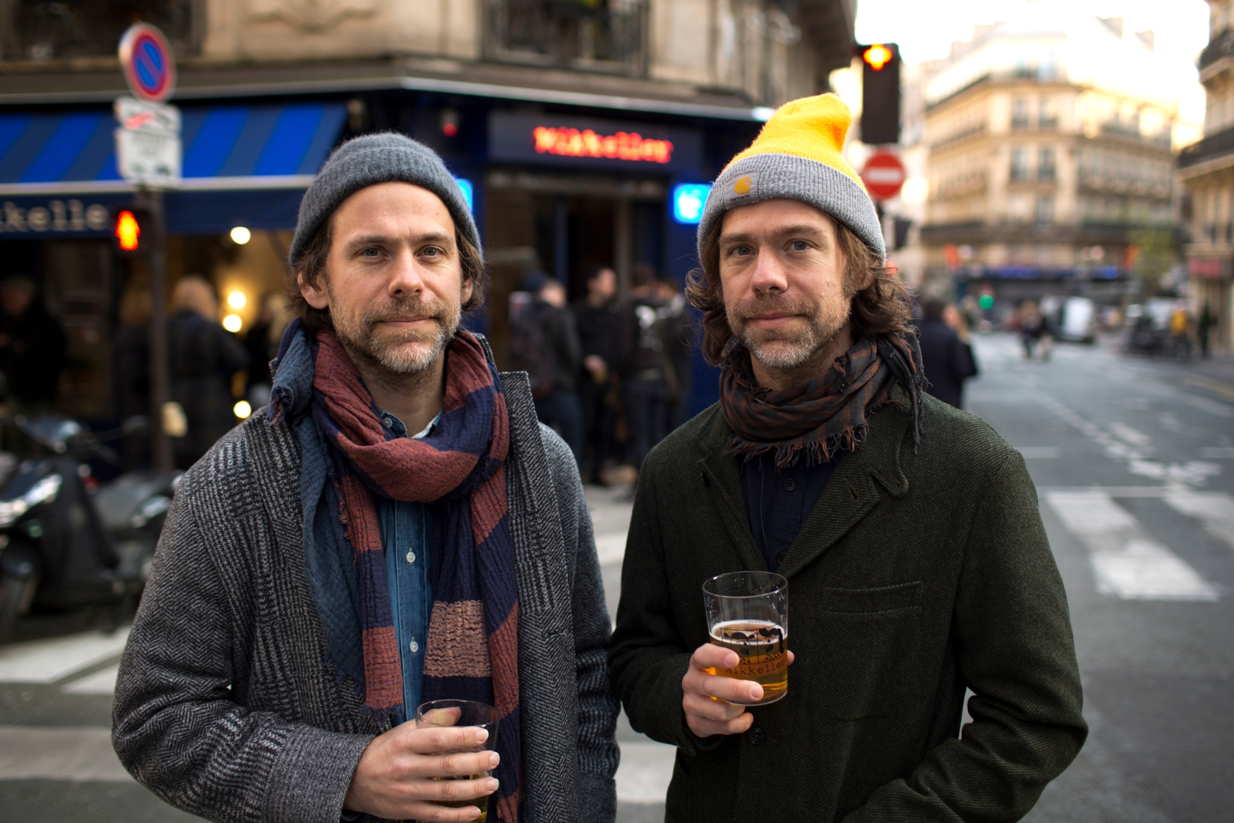 The Dessner brothers have a beer outside their new bar in Paris