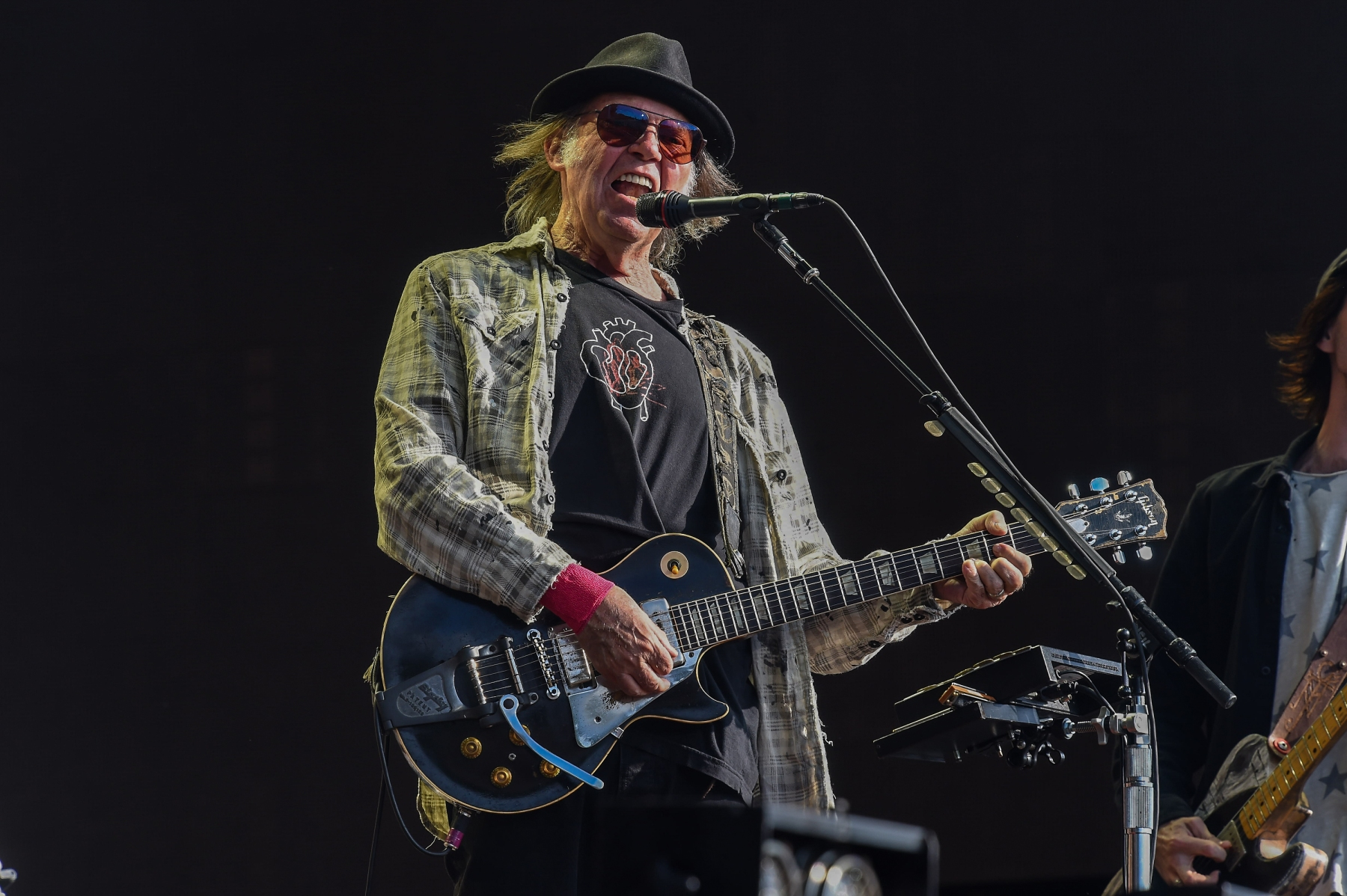 LONDON, ENGLAND - JULY 12: Neil Young performs as part of a historic double bill with Neil Young & Bob Dylan at Hyde Park on July 12, 2019 in London, England. (Photo by Brian Rasic/WireImage)
