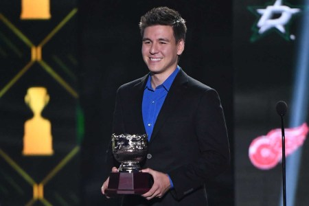 "Professional sports gambler and ""Jeopardy!"" champion James Holzhauer presents the Frank J. Selke Trophy during the 2019 NHL Awards at the Mandalay Bay Events Center on June 19, 2019 in Las Vegas, Nevada."