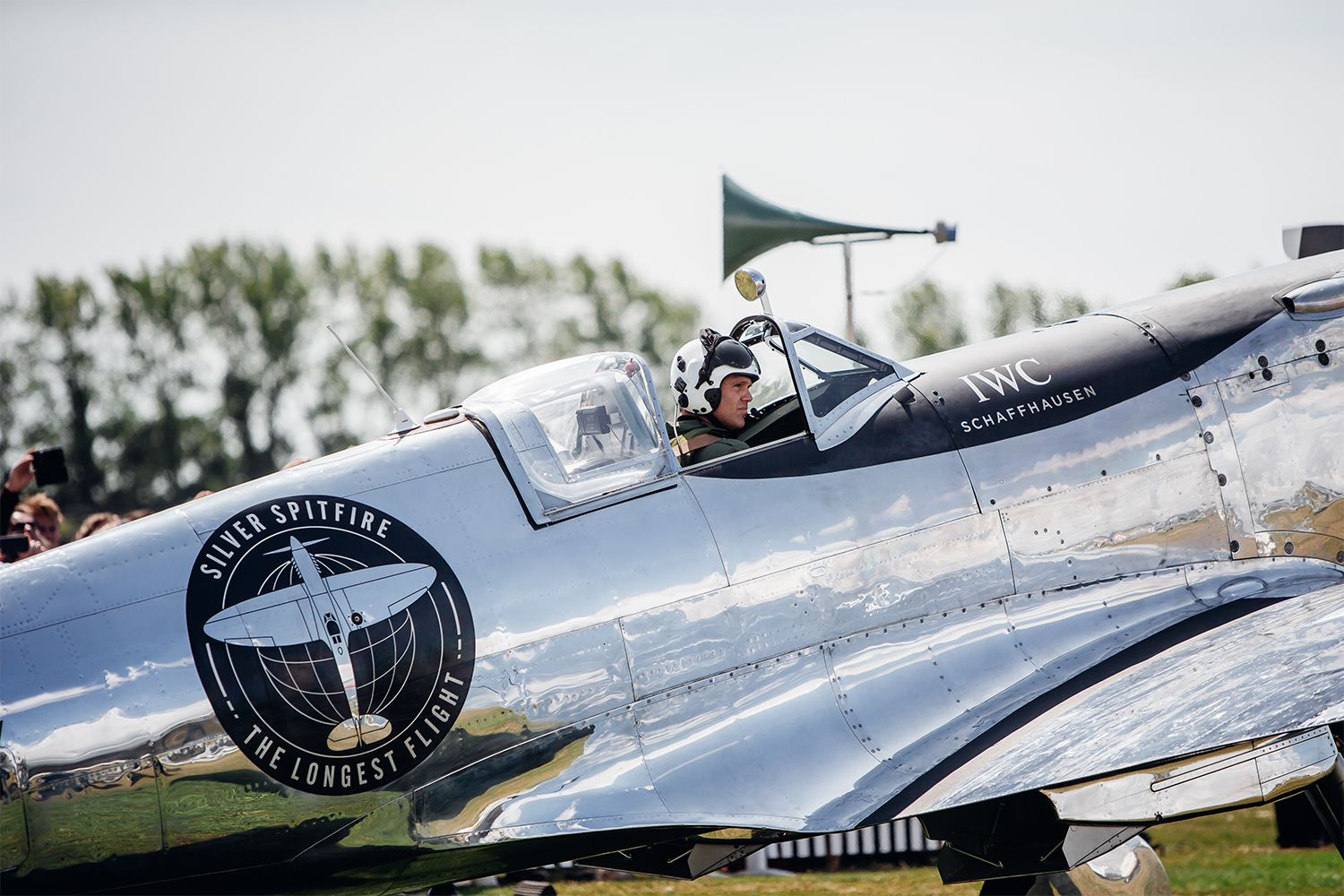 WWII Silver Spitfire Airplane at Goodwood Aerodrome