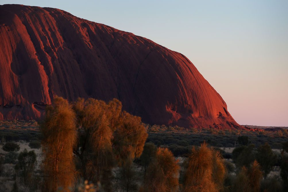 A general view of Uluru as seen from the designated sunrise viewing area in the Uluru-Kata Tjuta National Park, Australia. The Uluru-Kata Tjuta National Park board decided unanimously that the climb will close permanently on October 26, 2019. (Photo by Lisa Maree Williams/Getty Images)
