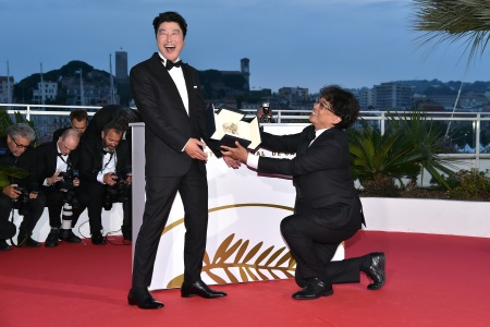 "Director Bong Joon-Ho, presents the Palme d'Or award for his film ""Parasite"" to Kang-Ho Song. (Photo by Dominique Charriau/WireImage)"