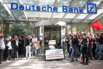 20 September 2019, Baden-Wuerttemberg, Stuttgart: Participants in a demonstration block the entrance to a Deutsche Bank branch. The demonstrators follow the call of the movement Fridays for Future and want to fight for more climate protection. They want to support the calls for strikes and protests all over the world. Photo: Sebastian Gollnow/dpa (Photo by Sebastian Gollnow/picture alliance via Getty Images)