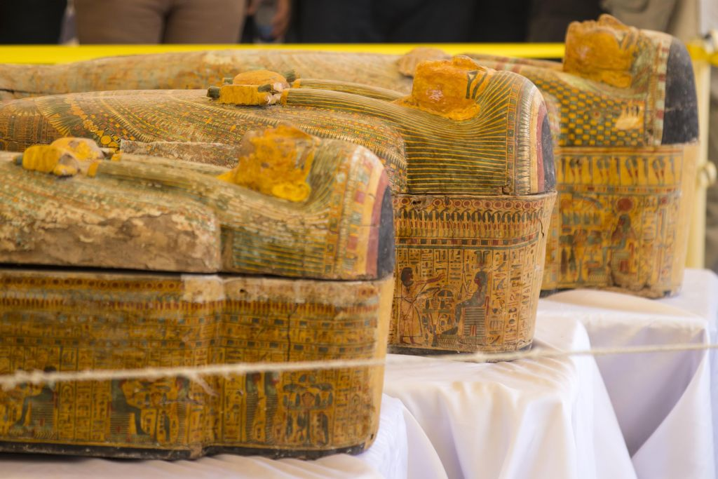 A photograph taken on October 19, 2019 shows sarchophagi displayed in front of Hatshepsut Temple in Egypt's valley of the Kings in Luxor - Egypt revealed today a rare trove of 30 ancient wooden coffins that have been well-preserved over millennia in the archaeologically rich Valley of the Kings in Luxor.(Photo by Khaled DESOUKI / AFP) (Photo by KHALED DESOUKI/AFP via Getty Images)