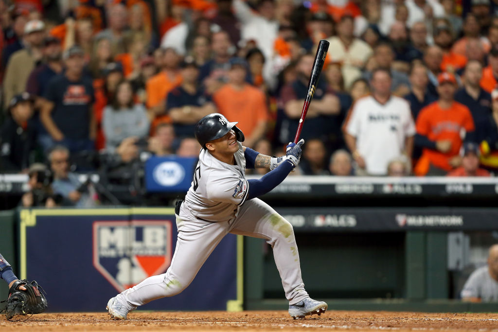 Gleyber Torres of the New York Yankees hits a two-RBI single against the Houston Astros during the seventh inning in game one of the American League Championship Series at Minute Maid Park on October 12, 2019 in Houston, Texas. (Photo by Bob Levey/Getty Images)