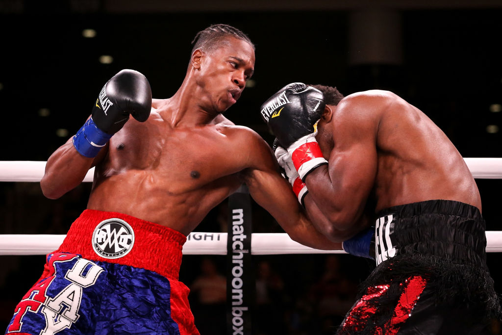 Patrick Day (L) lands a punch on Charles Conwell in the first round of their Super-Welterweight bout at Wintrust Arena on October 12, 2019 in Chicago, Illinois. (Photo by Dylan Buell/Getty Images)