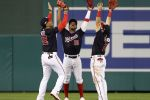 Juan Soto #22, Victor Robles #16, and Adam Eaton #2 of the Washington Nationals celebrate defeating the St. Louis Cardinals 8-1 after game three of the National League Championship Series at Nationals Park on October 14, 2019 in Washington, DC. (Photo by Patrick Smith/Getty Images)