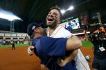 Jose Altuve of the Houston Astros is congratulated by his teammate Justin Verlander following his ninth inning walk-off two-run home run to defeat the New York Yankees 6-4 in game six of the American League Championship Series at Minute Maid Park on October 19, 2019 in Houston, Texas. The Astros defeated the Yankees 6-4. (Photo by Elsa/Getty Images)