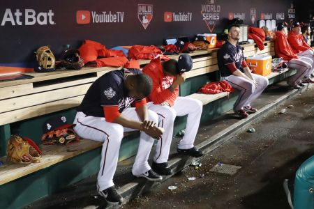 The Washington Nationals react against the Houston Astros during the ninth inning in Game Five of the 2019 World Series at Nationals Park on October 27, 2019 in Washington, DC. (Photo by Rob Carr/Getty Images)