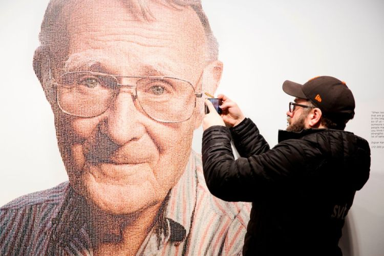 A visitor takes a mobile photo of a picture of Ingvar Kamprad, founder of Swedish multinational furniture retailer IKEA, at the IKEA museum in Almhult, Sweden, on January 28, 2018. (OLA TORKELSSON/AFP/Getty Images)