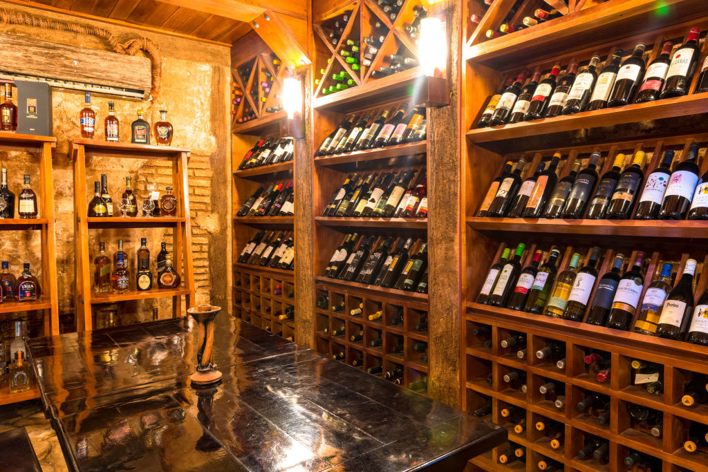 Wine cellar at the 'Tavern of the 7 Juanes'. The famous place sells a great variety of wines in the small colonial village. (Photo by Roberto Machado Noa/LightRocket via Getty Images)