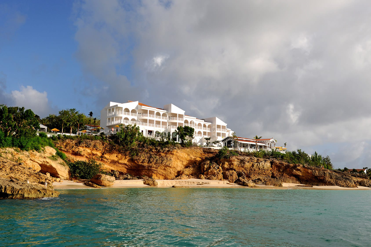 Wife of Man Accused of Murdering Anguilla Hotel Worker Speaks Out