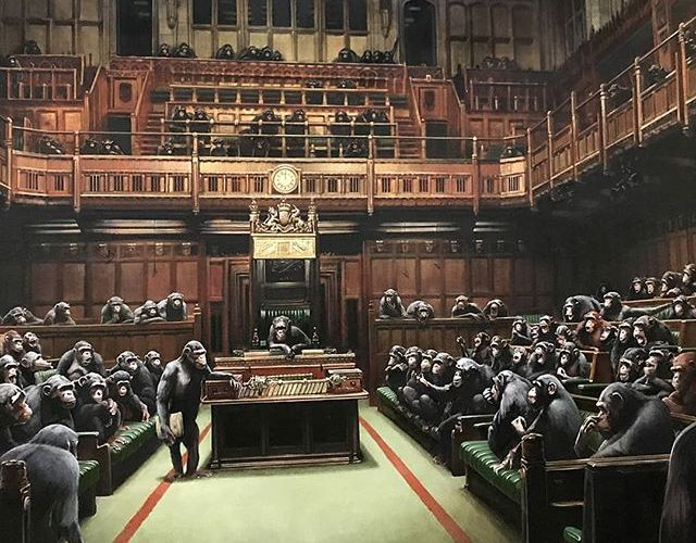 """Banksy Painting """"Devolved Parliament"""" Sells for $12 Million"""