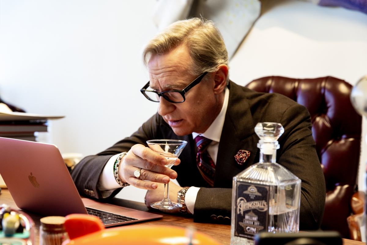 Paul Feig has a drink at his desk