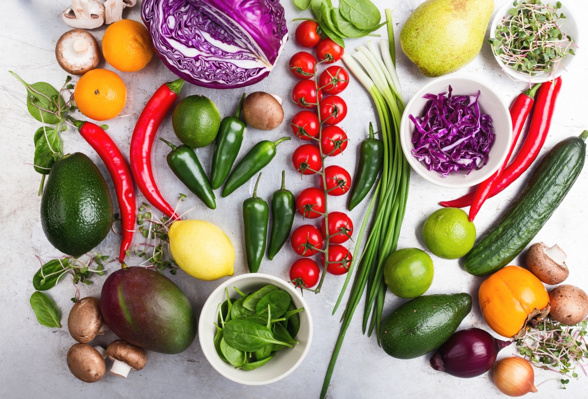 Selection of fresh  vegetables and fruits viewed from above.