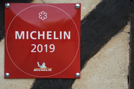A view of the 'Michelin 2019' sign seen outside a restaurant in Beuvron-en-Auge. in Caen, Normandy, France. (Photo by Artur Widak/NurPhoto via Getty Images)