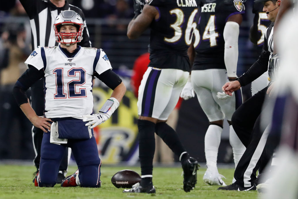 Quarterback Tom Brady of the New England Patriots reacts after being sacked against the Baltimore Ravens during the fourth quarter M&T Bank Stadium on November 3, 2019 in Baltimore, Maryland. (Photo by Scott Taetsch/Getty Images)