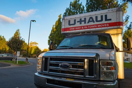 Front view of a U-Haul moving truck in the parking lot of an apartment complex in the San Francisco Bay Area, California, September 12, 2016. (Photo via Smith Collection/Gado/Getty Images).