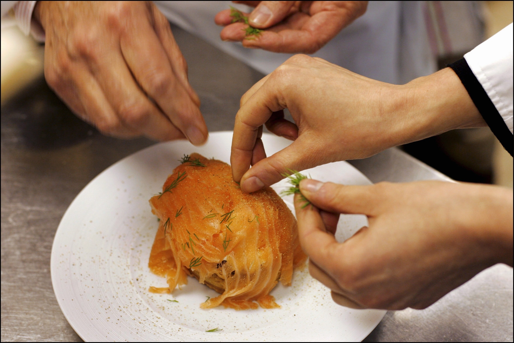chefs in Paris making food yum