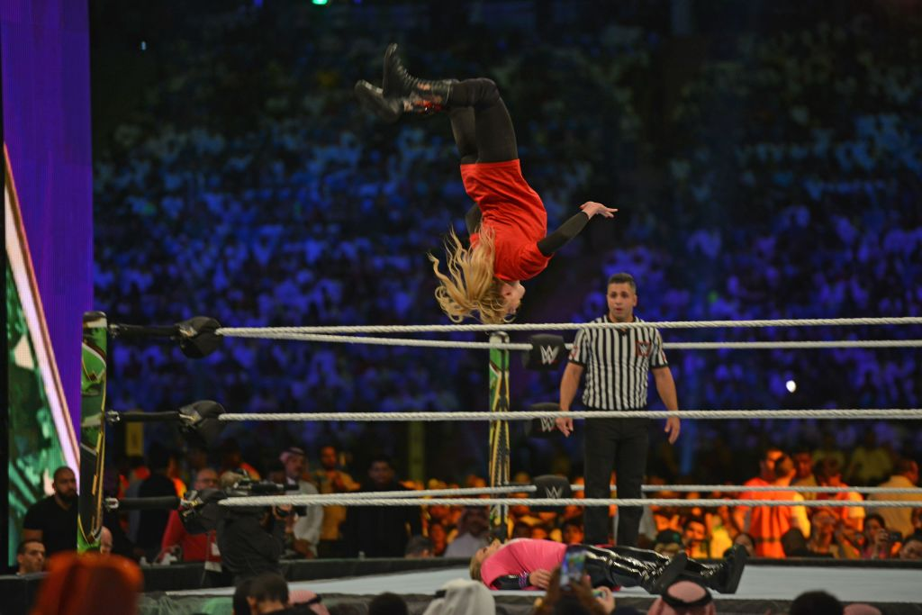 Lacey Evans (red) fights against Natalya during the World Wrestling Entertainment (WWE) Crown Jewel pay-per-view in Riyadh on October 31, 2019. (Photo by Fayez Nureldine / AFP) (Photo by FAYEZ NURELDINE/AFP via Getty Images)