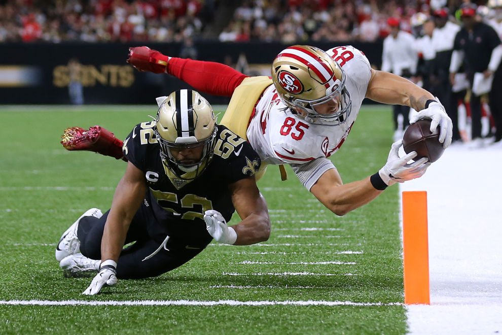 George Kittle of the San Francisco 49ers scores a touchdown as Craig Robertson of the New Orleans Saints defends during the second half of a game at the Mercedes Benz Superdome on December 08, 2019 in New Orleans, Louisiana. (Photo by Jonathan Bachman/Getty Images)