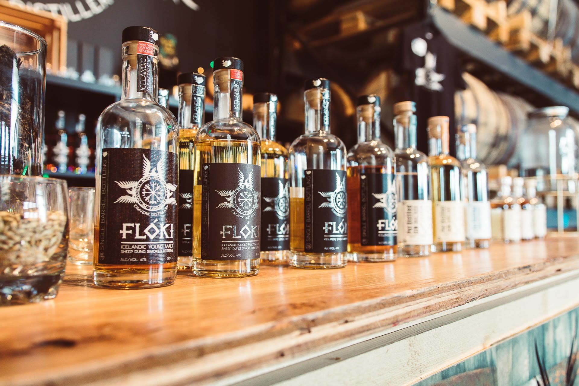 Numerous whisky bottles