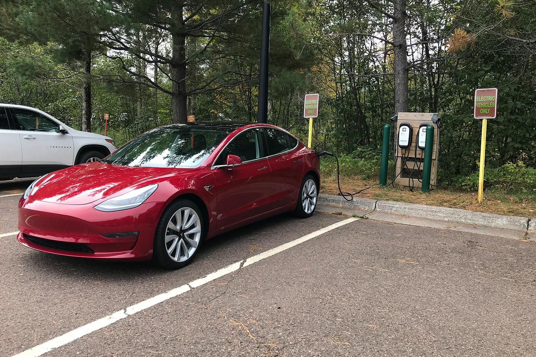 Tesla Model 3 charging at a state park