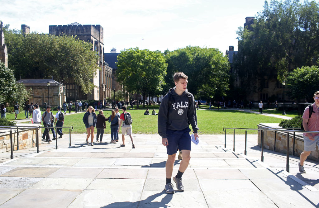Students walk through the campus of Yale University (Photo by Yana Paskova/Getty Images)