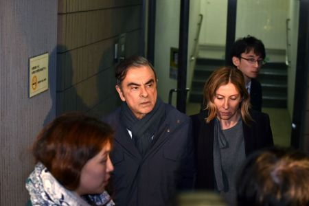 Former Nissan Chairman Carlos Ghosn and his wife Carole leave the office of his lawyer Junichiro Hironaka in Tokyo on April 3, 2019. (Photo by Kazuhiro NOGI / AFP)