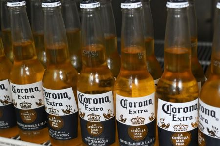 Picture of bottles of Mexican beer Corona, taken in Mexico City on June 4, 2019. (Photo by Rodrigo ARANGUA / AFP)