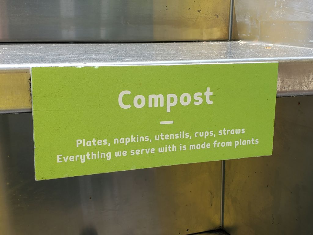 Sign above compost bin in restaurant in Dublin, California, stating that all silverware and other serving ware is made from compostable materials, July 30, 2019. (Photo by Smith Collection/Gado/Getty Images)