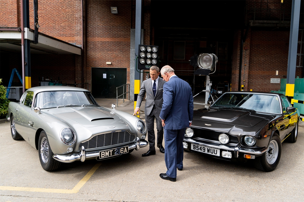 Aston Martin DB5 and V8 with James Bond's Daniel Craig and Prince Charles