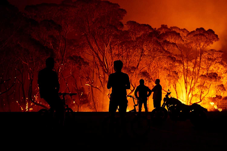 Flames burn through bush in Lake Tabourie, Australia